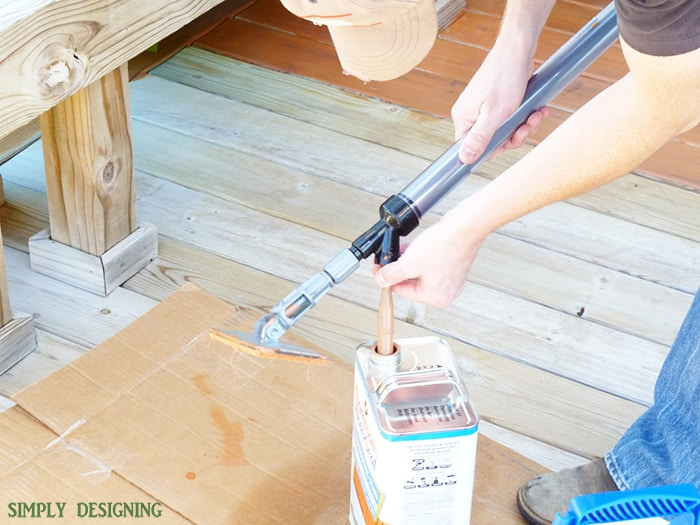 putting stain in stain applicator
