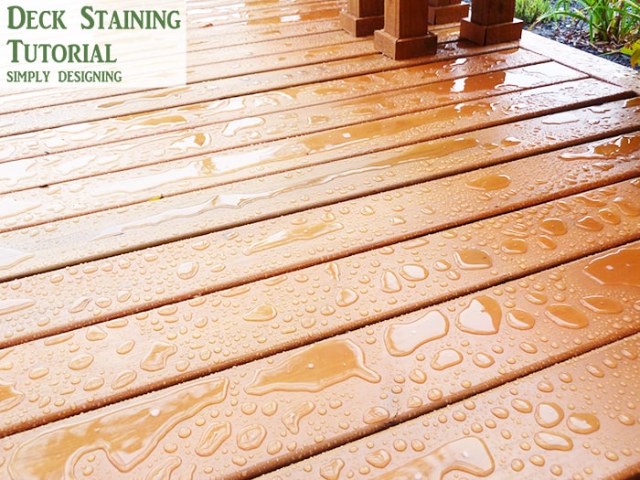 rain sitting on top of stained deck