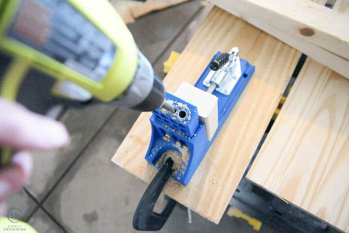 close up of using kreg jig to build floating shelves