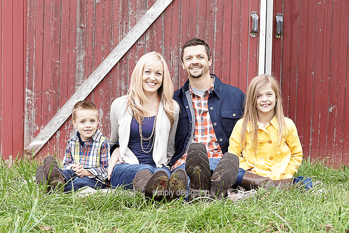 Family Photo of everyone sitting in the grass in front of a barn door