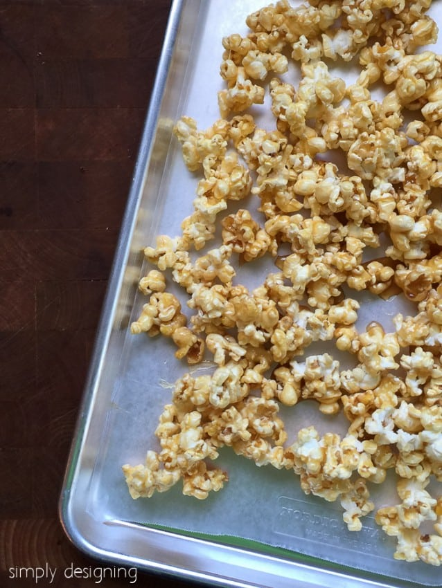 easy caramel popcorn recipe spread out on a tray