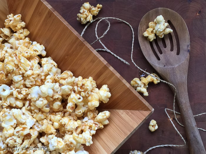 quick caramel popcorn in a wooden bowl