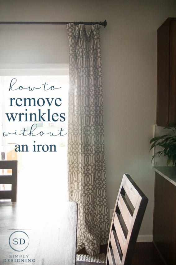 Main photo for how to get creases out of curtains showing a tan and cream patterned curtains hanging on a metal rod by kitchen table and chairs