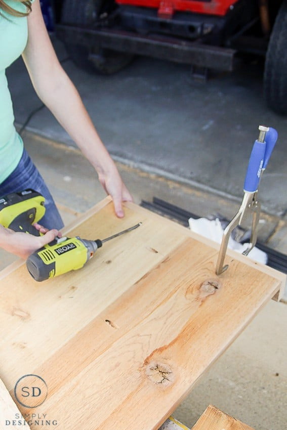 """Using Ryobi Drill to secure 1x3"""" sides to 3 sides of each shelf for the printer table using pocket holes"""