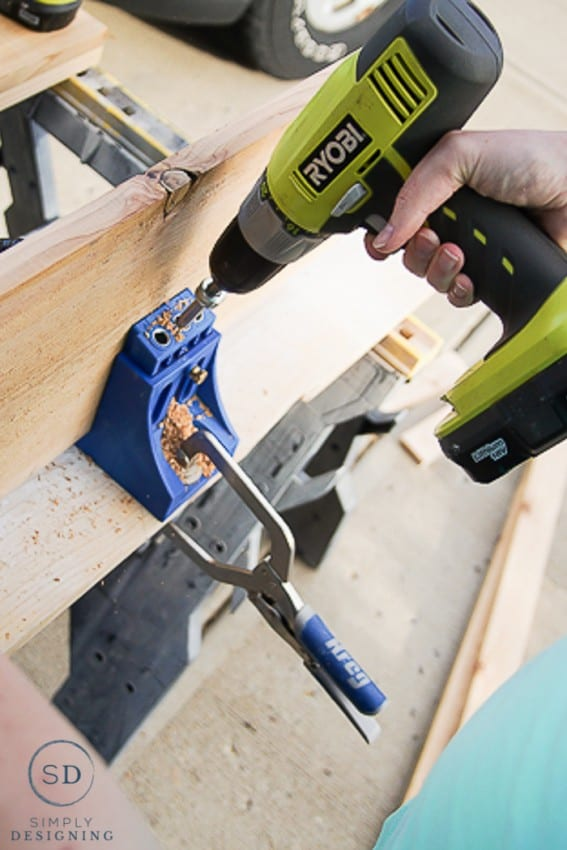 Using a Kreg jig and Ryobi Drill to make holes to join two boards together to make shelves for DIY Printer Cart