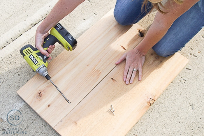"""Making shelves for Printer Table using Ryobi drill to screw 2 10"""" wide boards together using pocket holes"""