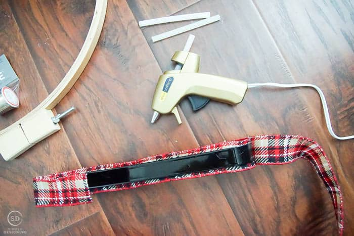 Glue ribbon to wreath hanger