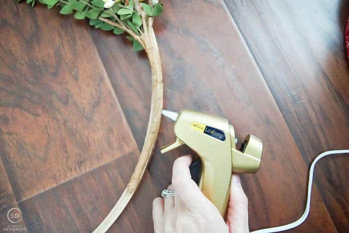 Hot glue stems to wreath