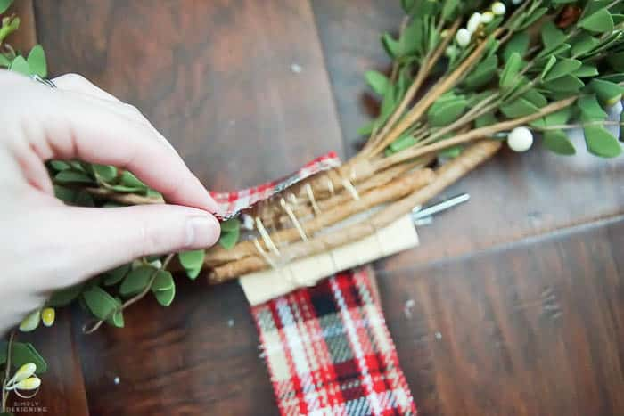 Cover middle of wreath stems with ribbon