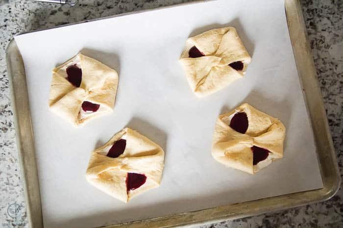 put berry cheese danish on baking sheet