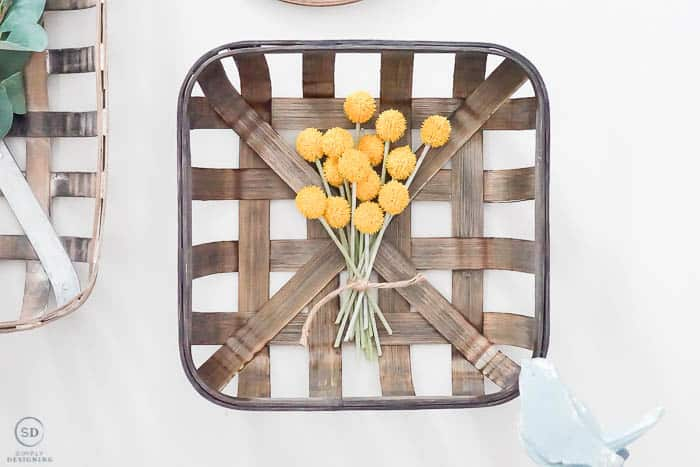 yellow flowers on tobacco basket