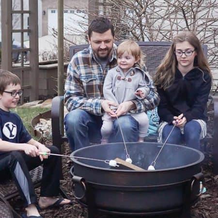 Sitting around a fire pit roasting marshmallows