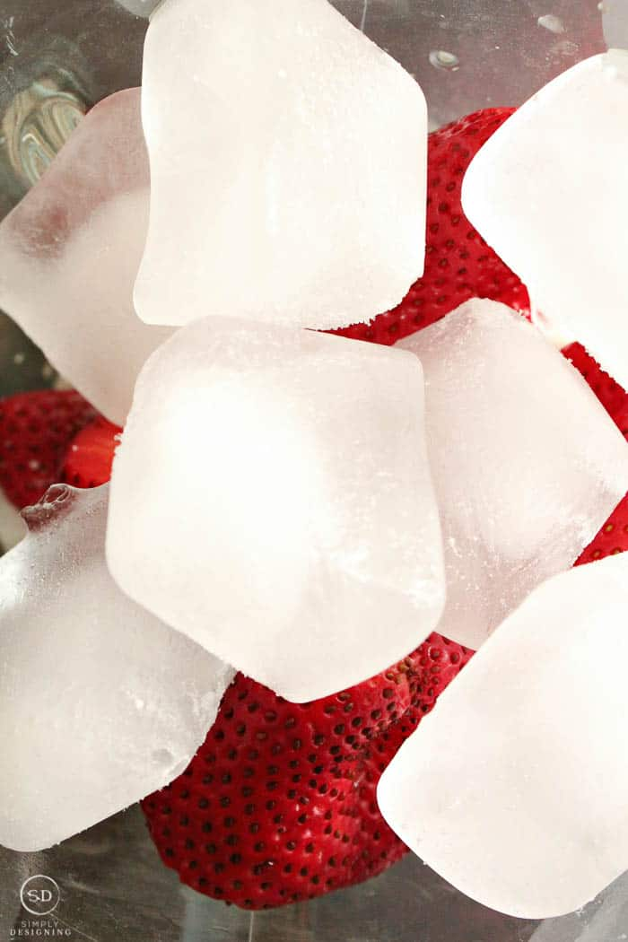 ice and strawberries in a blender