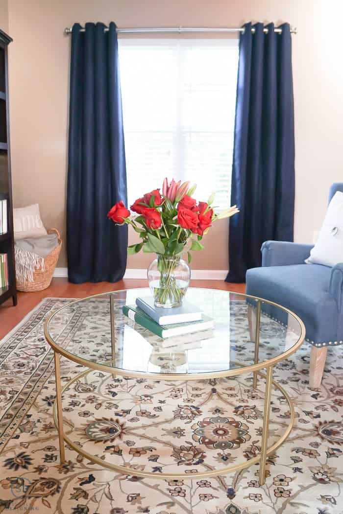 navy blue curtains and gold coffee table in front room makeover