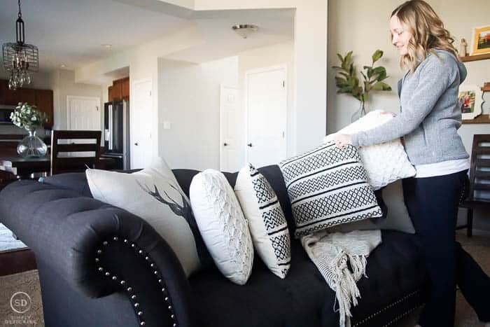 remove pillows and blankets from couch before cleaning it