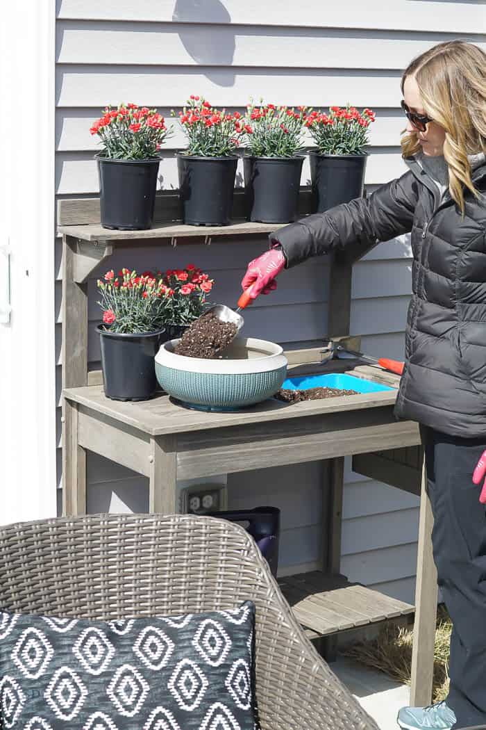 add soil to outdoor pot