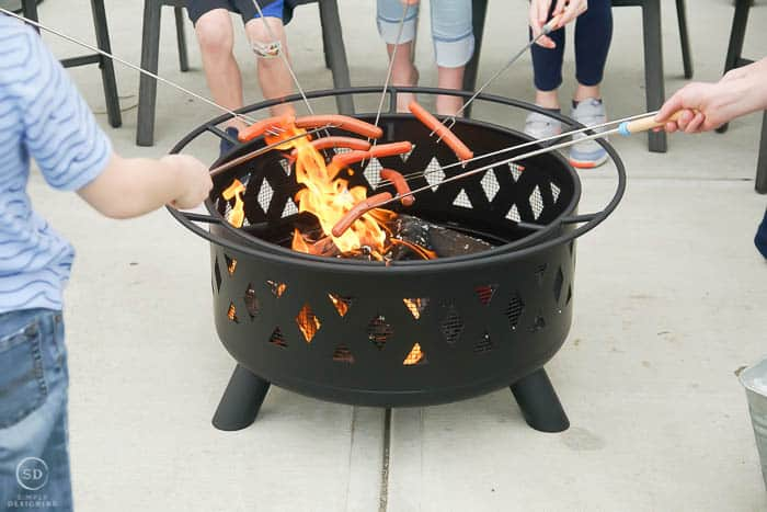 roasting hot dogs over fire pit