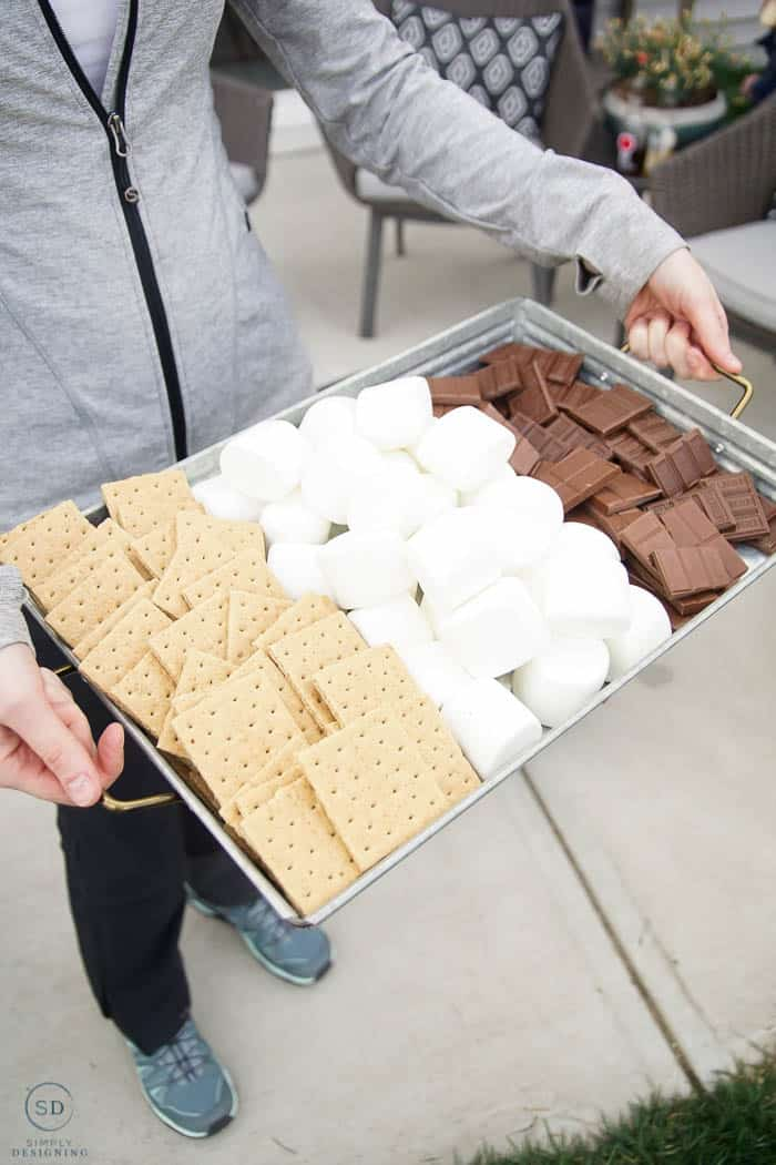 s'mores ingredients on galvanized tray