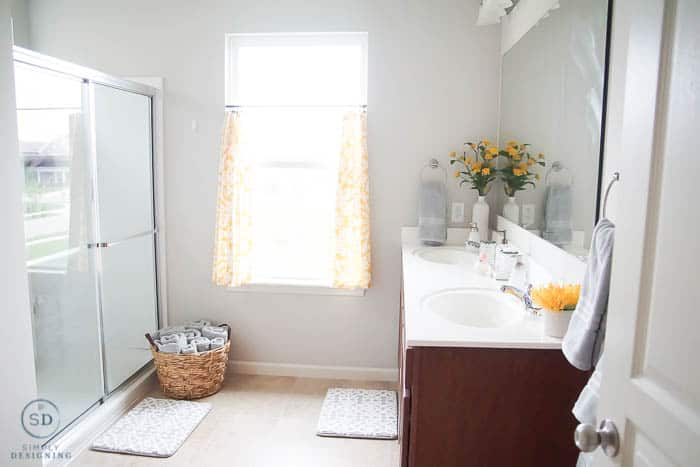 Budget-friendly bathroom makeover with pops of yellow and a lot of neutral gray.