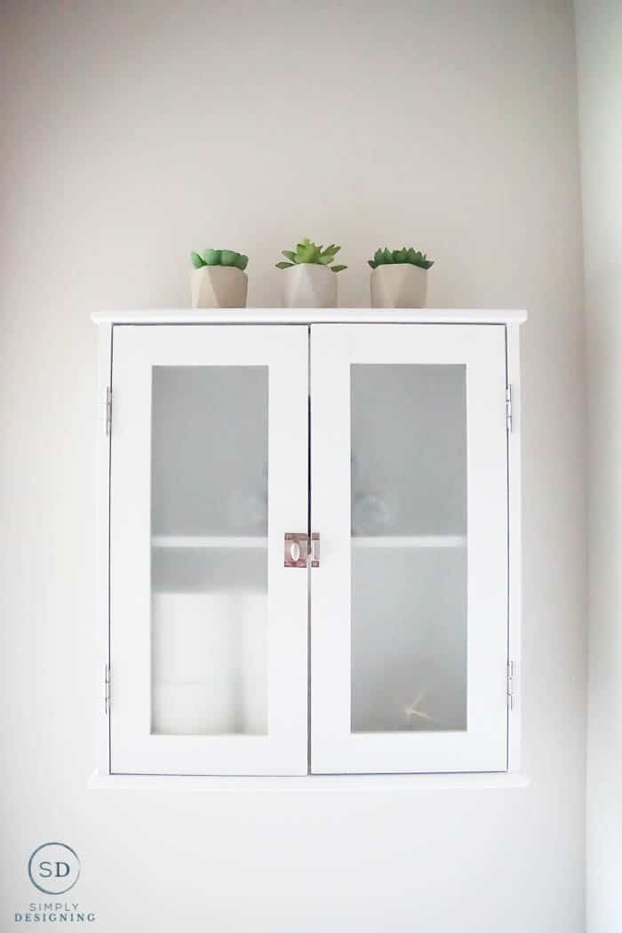 cute white wall storage for your bathroom