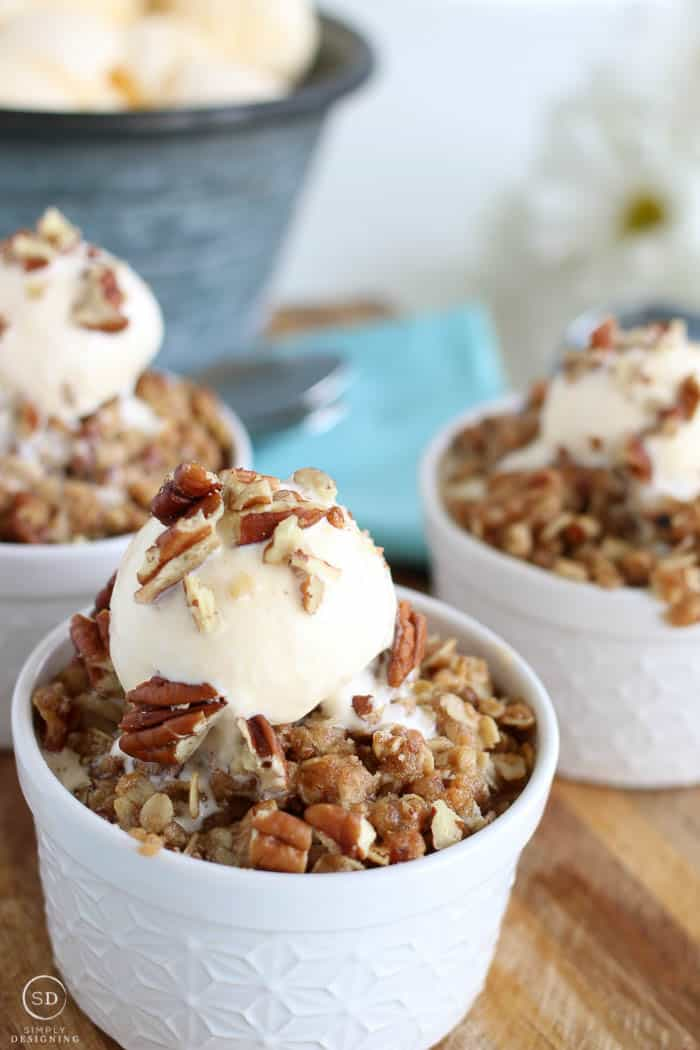 Closeup view of an easy rhubarb crisp served with ice cream on top