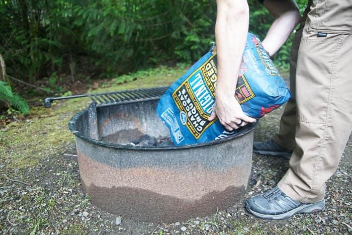 pour charcoal into fire pit