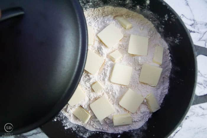 place lid on dutch oven for easy peach cobbler