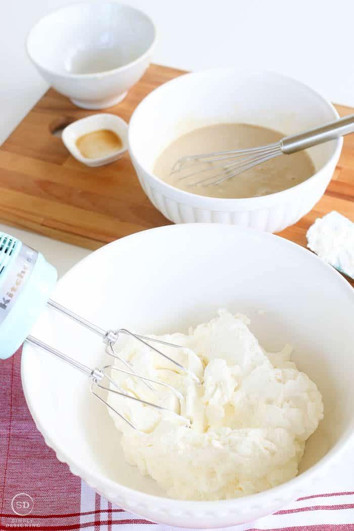 Cream whipped till fluffy for homemade vanilla ice cream.