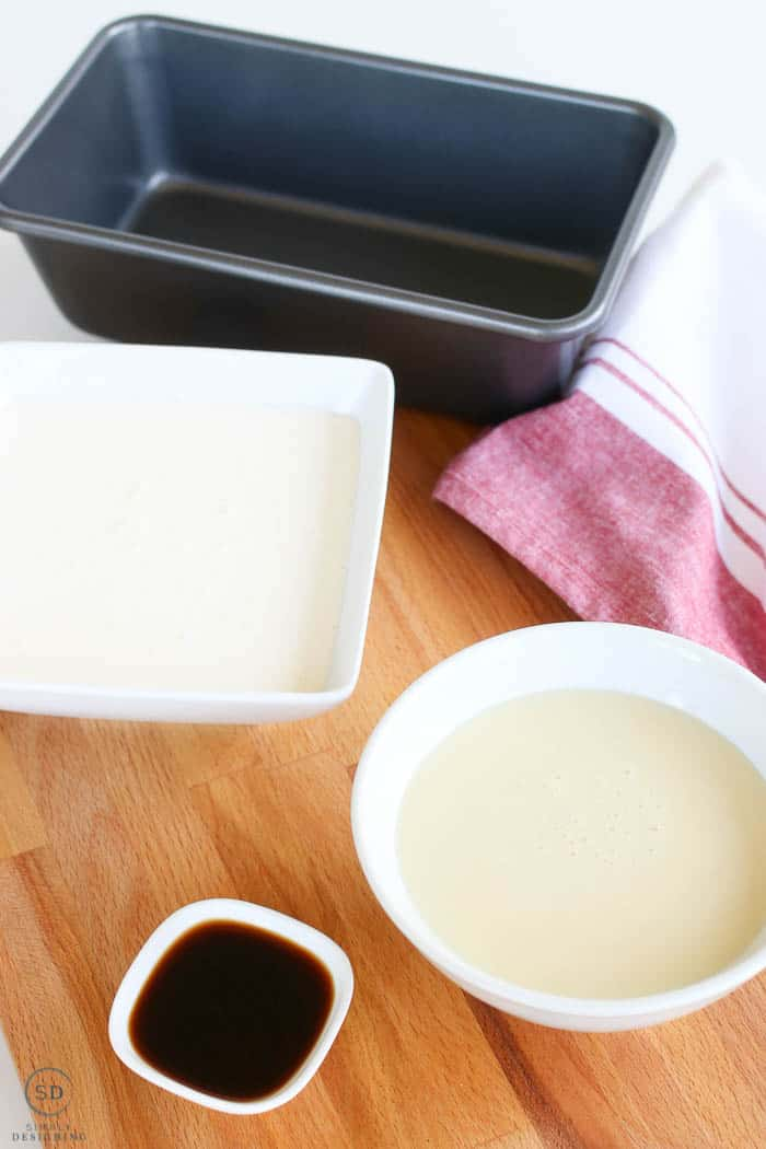 Simple ingredients for homemade ice cream, whipping cream, sweetened condensed milk, and vanilla for flavoring.