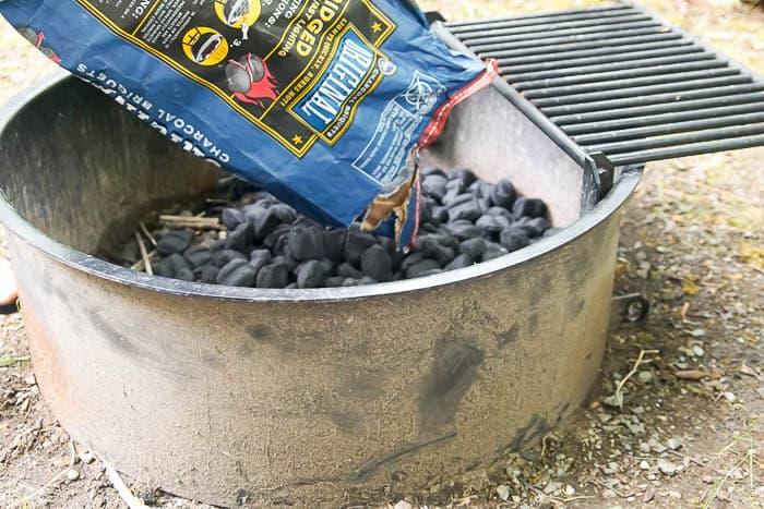 pour charcoal into firepit