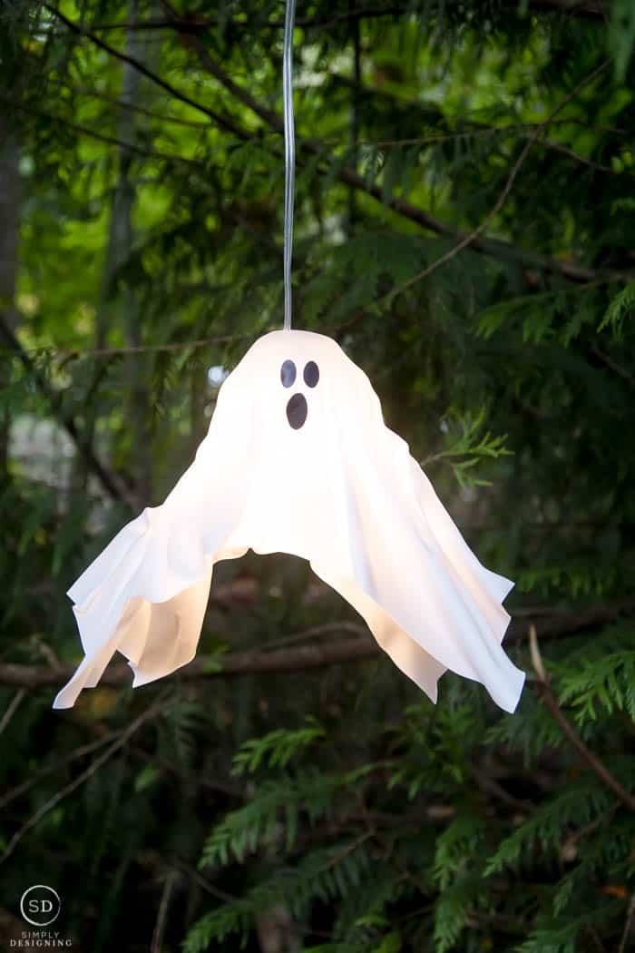 DIY Hanging Ghost Lantern hanging in a tree and turned on