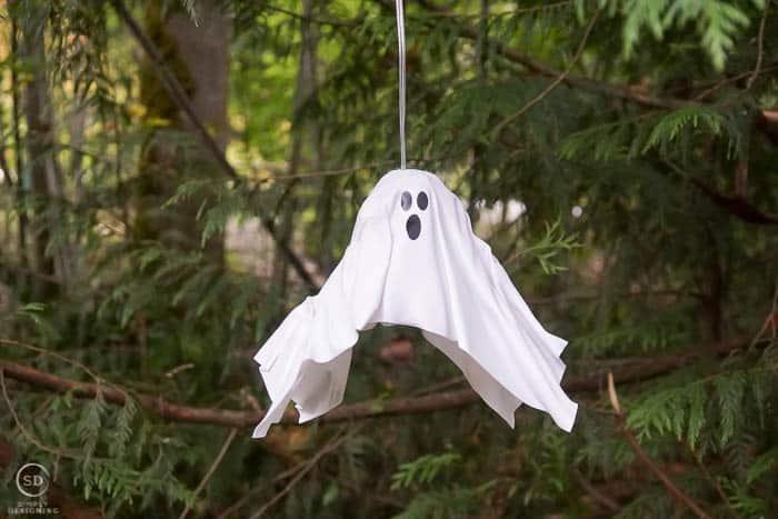 plastic white diy hanging ghost lantern hanging in a tree