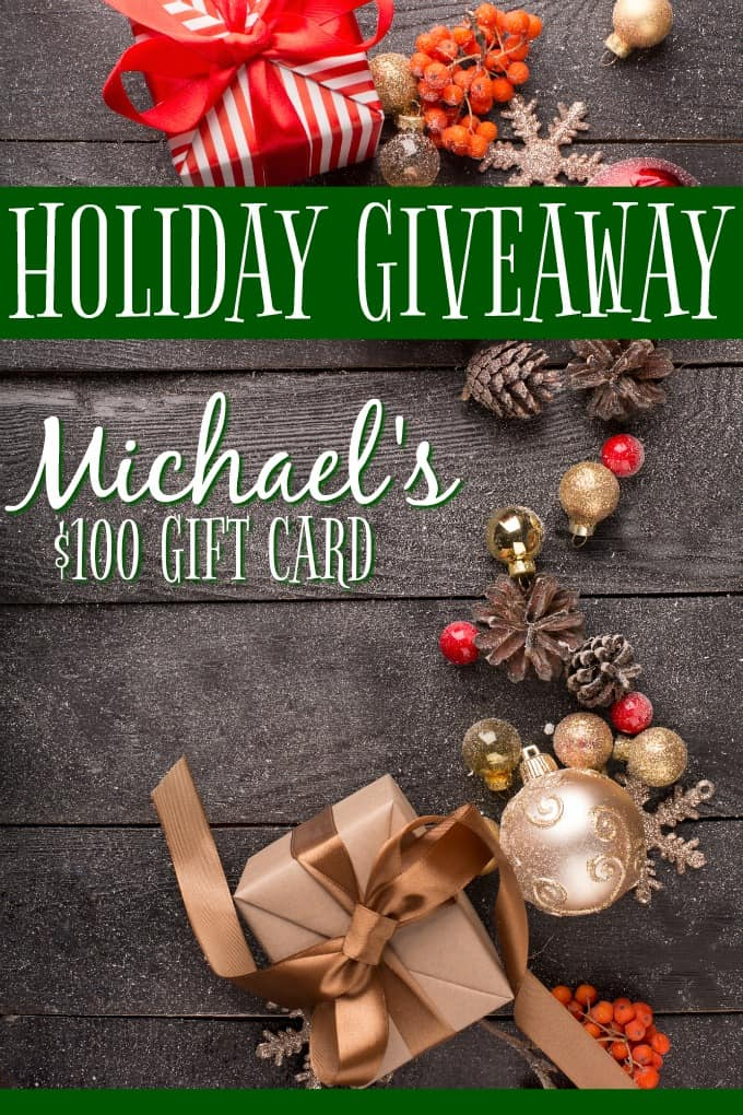 2019 Holiday Michaels Giveaway - Christmas still-life with red and golden ornaments, fir-cones on a wooden table