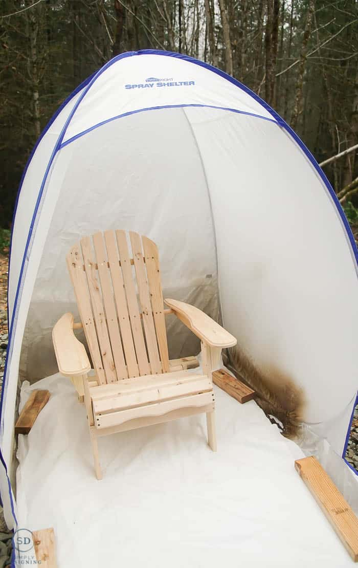 raw wood chair in paint spray shelter