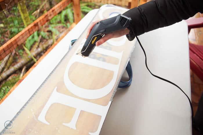 use heat gun to melt wax on bottom of snowboard