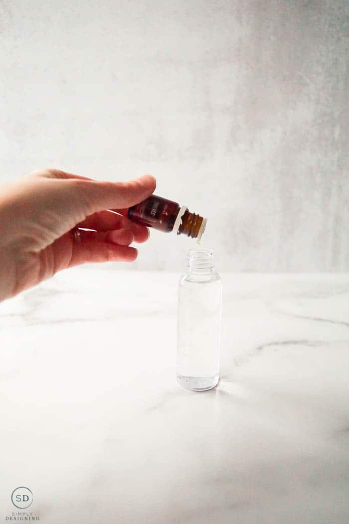 drop thieves essential oil into spray bottle