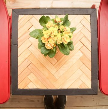 herringbone side table with yellow flowers on top