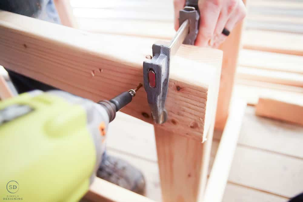 using a clamp to hold boards together while screwing them together