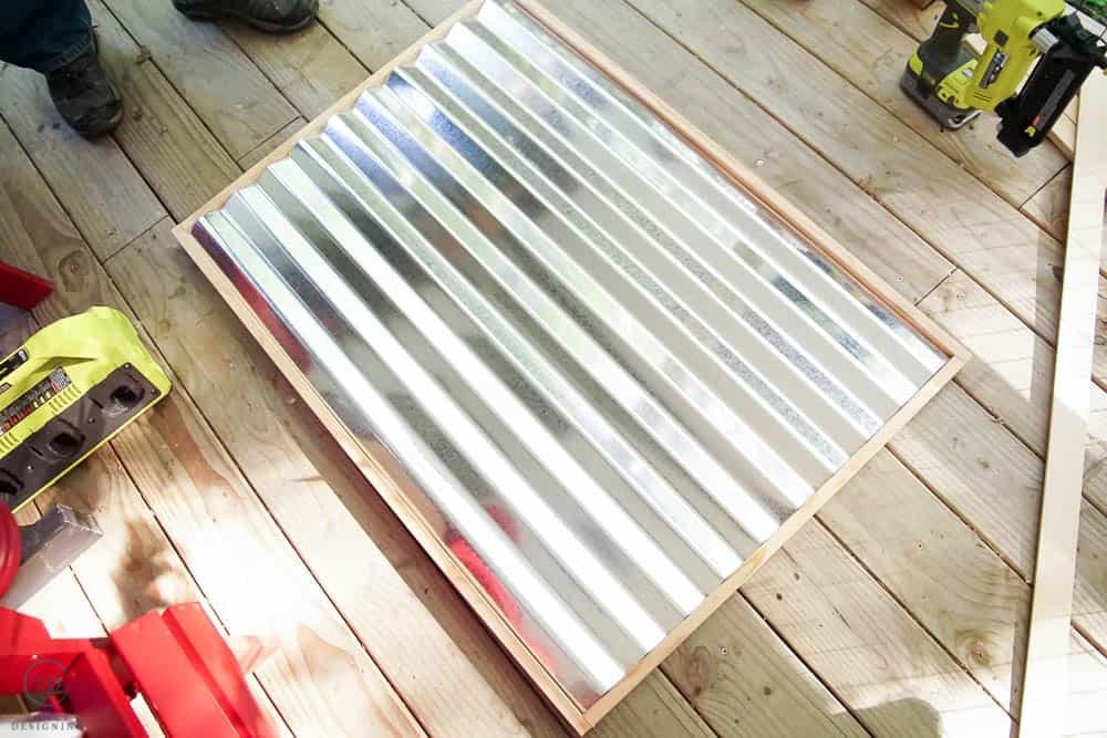 roof frame with sides on and corrugated metal sitting on top to check sizing
