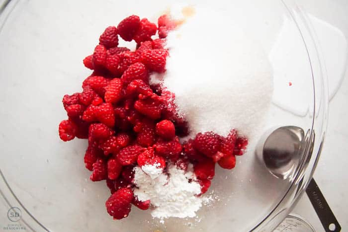 ingredients for raspberry crisp filling in a glass bowl
