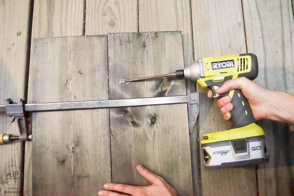 use a kreg jig to attach two boards together