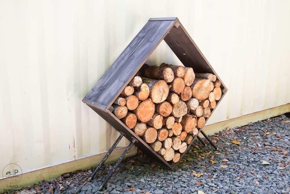 firewood holder with pipe legs
