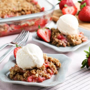 crisp made with rhubarb and strawberries served on a plate with ice cream