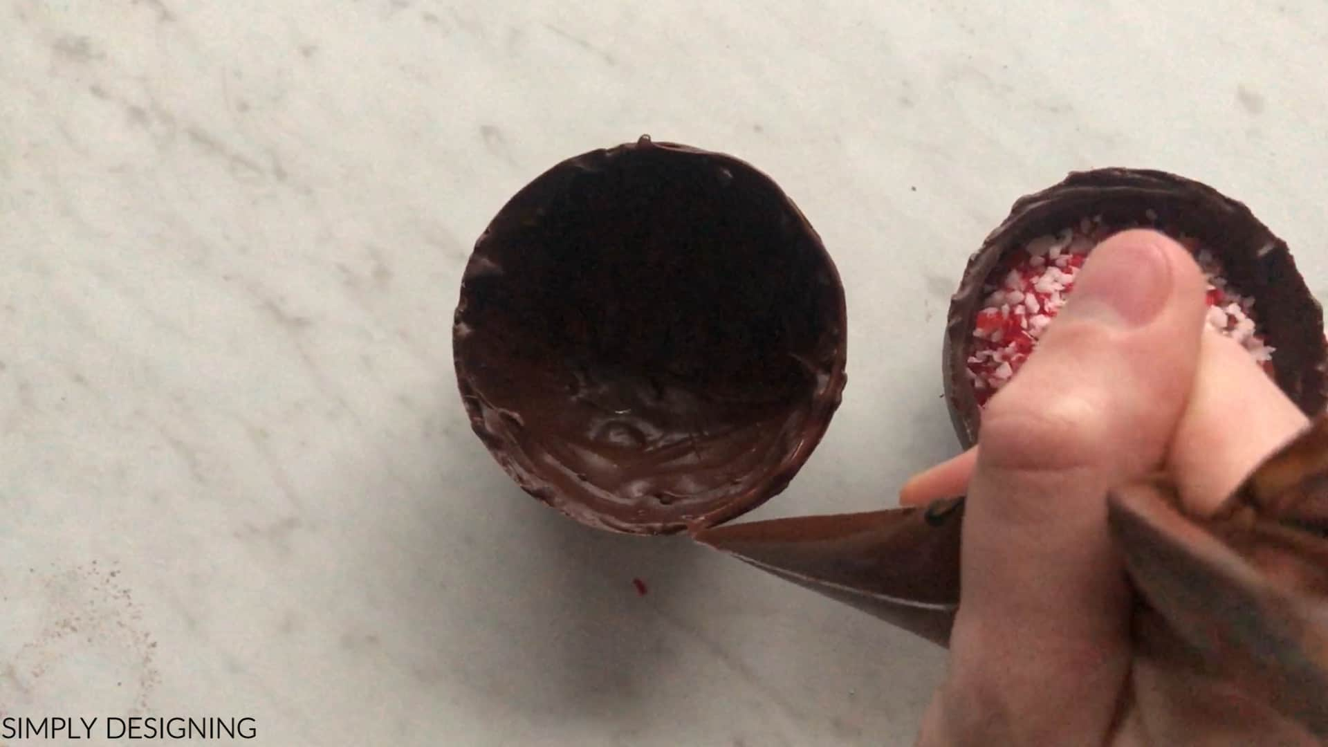 use melted chocolate to attach chocolate bomb